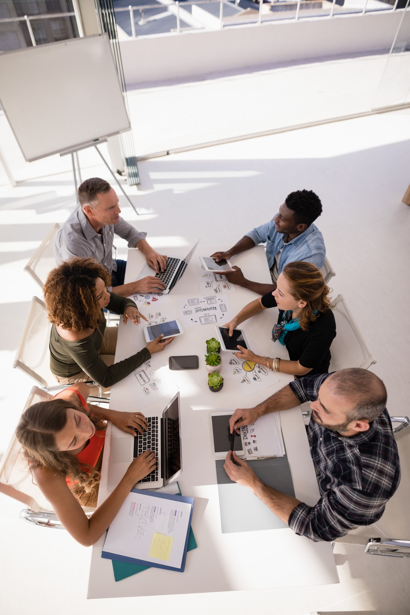 Executives interacting with each other during meeting